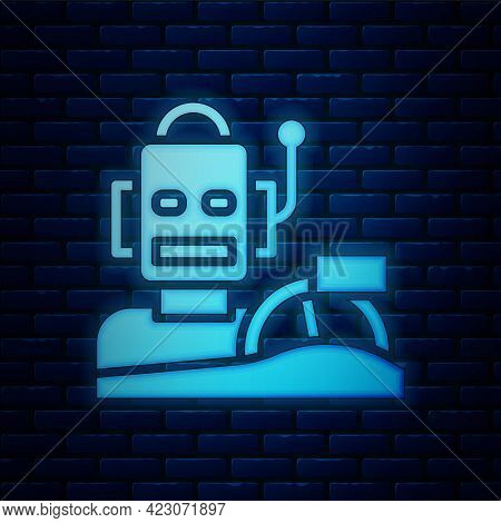 Glowing Neon Robot Humanoid Driving A Car Icon Isolated On Brick Wall Background. Artificial Intelli