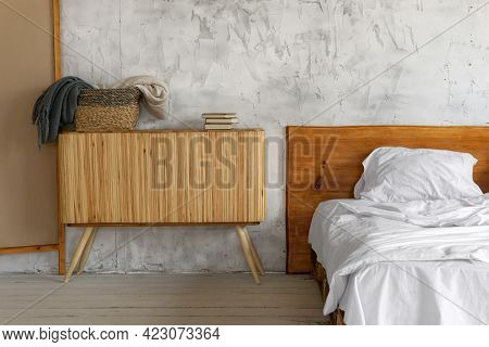 Closeup View On Spacious Airy Eco Style Light Loft Bedroom With A Bed And Commode