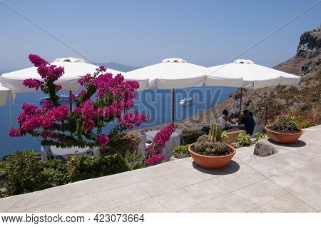 Beautiful Terrace With Umbrellas And Panoramic Views Of The Sea And The Caldera On The Island Of San