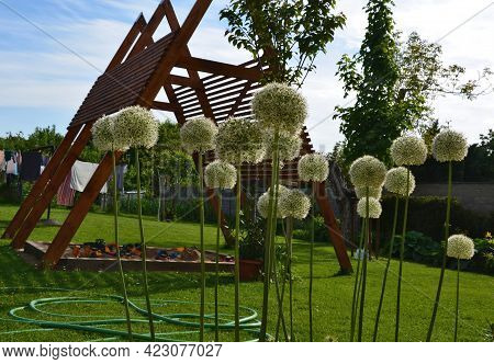 Construction Of A Pergola Shading The Kindergarten Playground With A Sandpit. Board Battens Are Just