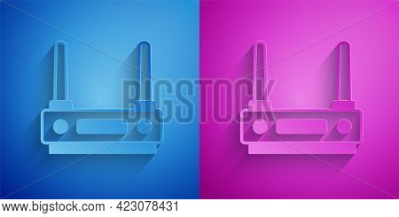 Paper Cut Router And Wi-fi Signal Icon Isolated On Blue And Purple Background. Wireless Ethernet Mod