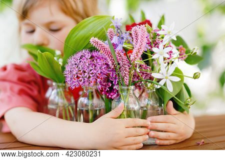 Close Up Of Little Preschool Girl With Flower Bouquet At Home. Close-up Of Toddler Child And Colorfu