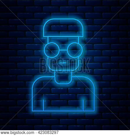 Glowing Neon Line Nerd Geek Icon Isolated On Brick Wall Background. Vector