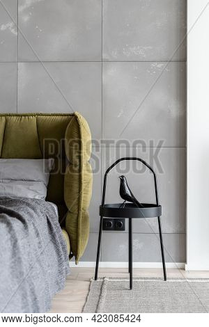Vertical Shot Of Minimal Style Bedroom In Monochrome Colors With Big Comfy Bed Covered With Gray Bed