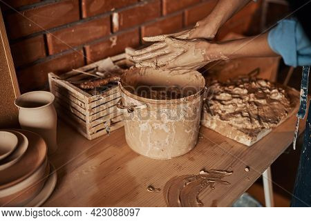 Beautiful Elegant Craft Woman Arms Shaping Something With Earthenware Ingredient In Pottery Workshop