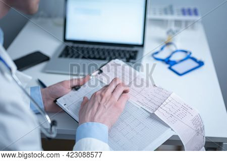 Topic Of Timely Checking For Heart Disease. Heart Disease Myocardial Infarction. Doctor Analyzing El