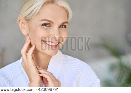 Closeup Of Happy Smiling Beautiful Middle Aged Woman Spa Salon Client Wearing Bathrobe Looking At Ca
