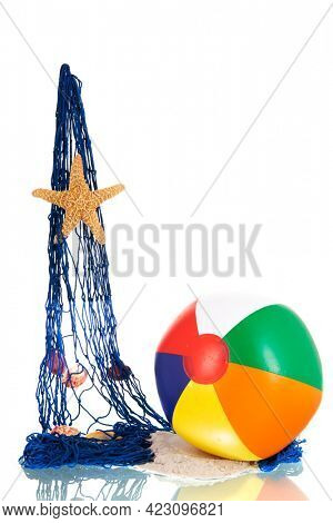 Blue fishing net and beach ball with shells isolated over white background