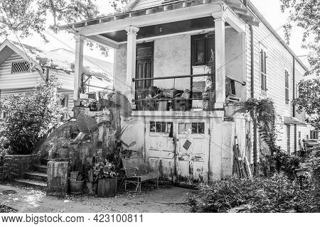 New Orleans, La - May 30: Old Worn Uptown House With Cluttered Front Porch And Yard In Black And Whi