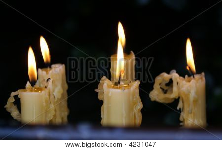 Candles burning inside of a chaple in braga portugal poster