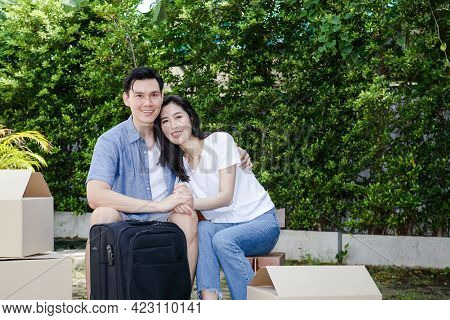 Asian Men And Women Couple Moving Into A New Home. They Are Happy To Build A Family Together. Concep