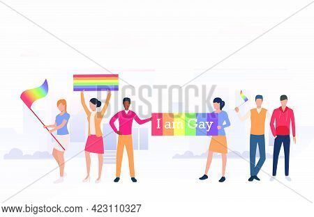 People Holding Lgbtq Flags And I Am Gay Banner In Parade. Diversity, Discrimination, Freedom Concept