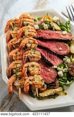 Blue Cheese Surf And Turf Shrimp And Steak Salad Cooked Rare With Kalamata Olives And Artichoke Hear