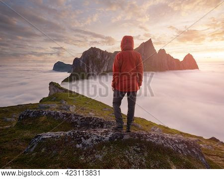 A Tourist Enjoying A View At The Mountain Hesten, Senja, Norway. Trekking In Norway, Active Life Con