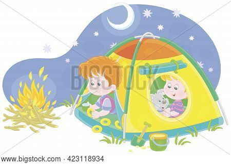 Cheerful Little Kids Tourists With A Merry Pup Resting In Their Colorful Camp Tent On A Starry Night