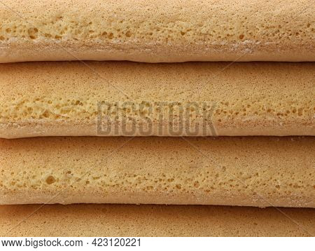 Close Up Of Stacked Italian Savoiardi Cookie, Biscuit Background, Texture Of Biscuits