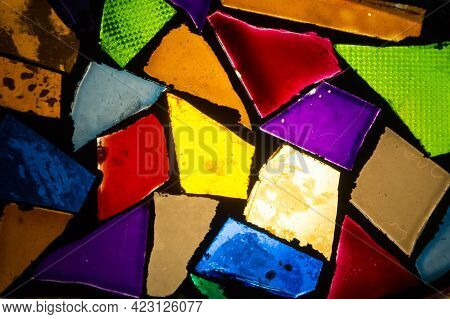 Glass Pieces Of Different Shapes And Textures Are Painted In Different Colors, Assembled In A Random