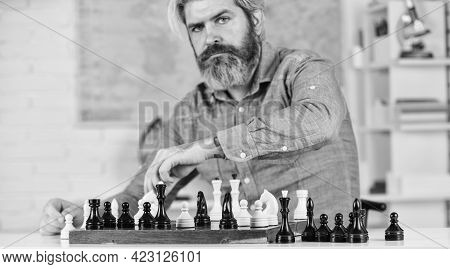 Development Logics. School Teacher. Playing Chess. Intellectual Hobby. Chess Lesson. Strategy Concep