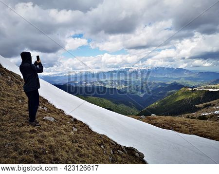 Hiker In The Mountains, Early Spring With Snow