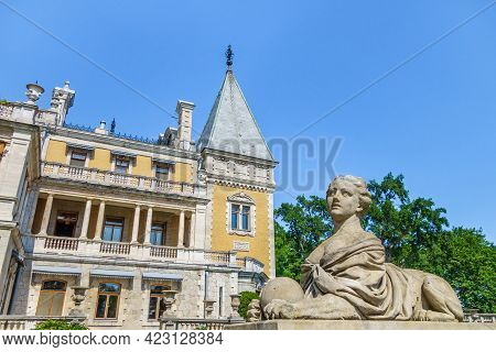 Sphinx With Female Head Against Building Of Massandra Palace. Complex Was Founded In 1881 By Prince