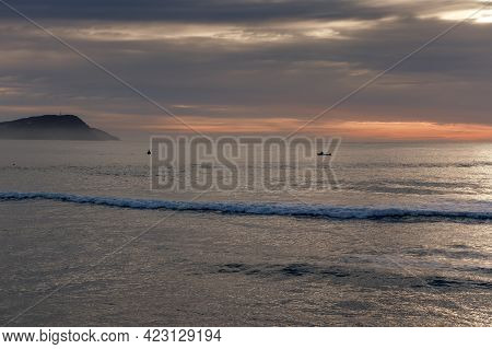 Photograph Of Small Fishing Boats In The Pacific Ocean At Terrigal Beach At Sunset On The Central Co