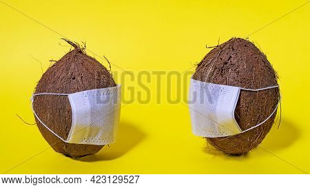 Coconut Mask. Safety In Tropical Countries. Coronavirus Covid-19. Social Distance On Vacation. Space