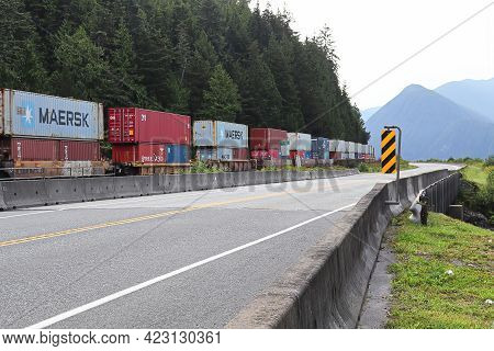 Basalt Creek, Canada - August 8, 2019: A Train Carries Containers Full Of Items From The West Coast,