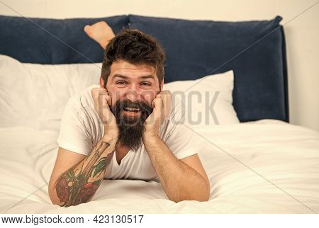 Free Your Smile. Happy Hipster Smile In Bed. Bearded Man With Healthy Smile. Morning And Night Oral