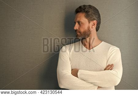 His Hair Is Styled Appropriately. Bearded Man Keep Arms Crossed Grey Wall. Confident Mature Adult Wi