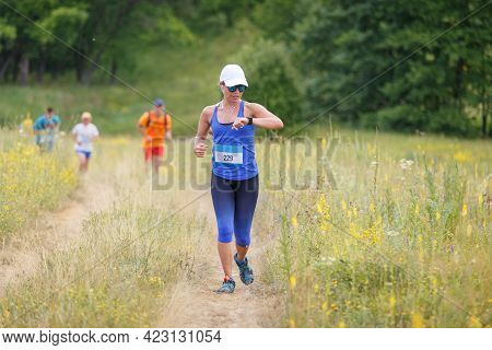 Young Woman Checking Up Her Time On Running Cross