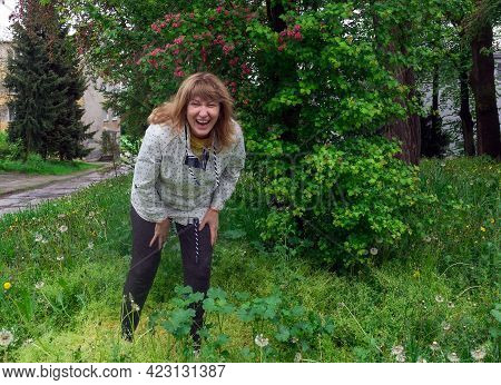 Middle-aged Woman, Laughing Cheerfully, Pretty, Positive, Cheerful, Resting In Nature