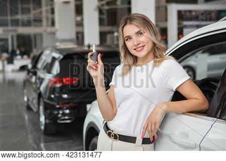 Beautiful Young Woman Holding Car Key, Leaning On Her Newly Bought Automobile