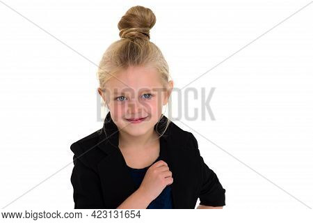 Portrait Of A Cute Six Year Old Girl. Beautiful Blonde Little Girl With Ponytail Wearing Stylish Fas