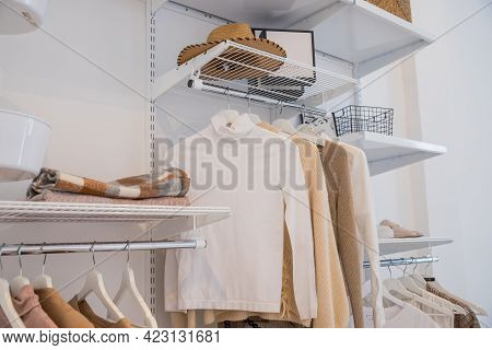 Interior Of Show Room With Stylish Clothes And Accessories.collection Of Female Clothes Hanging On R