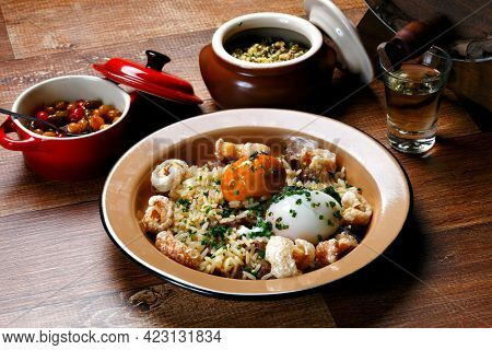 Rice with Pequi, crackling and boiled egg