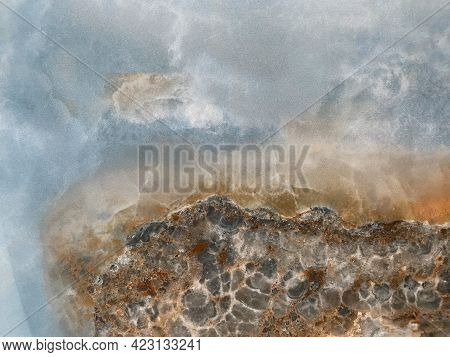 The Background Is Made Of Marble With Shades Of Blue, Gray, And Brown. The Texture Of Marble. Marble