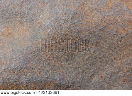 Background Of A Powerful Piece Of Iron, Slightly Corroded By Rust.