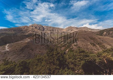 Panoramic View Of Table Mountain In Ingushetia, Russia. Mountain Landscape, Rocks, Plateau And Blue