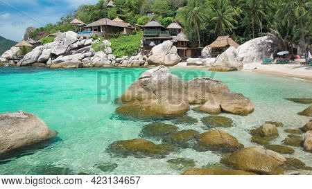 A Large Pool Of Water In Front Of A Rock Indonesia Bali. A Large Pool Of Water In Front Of A Rock. H