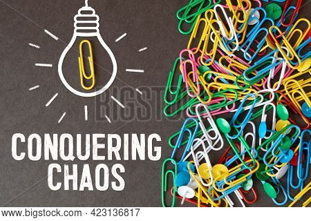 Text Conquering Chaos, Business Concept, On Black Background