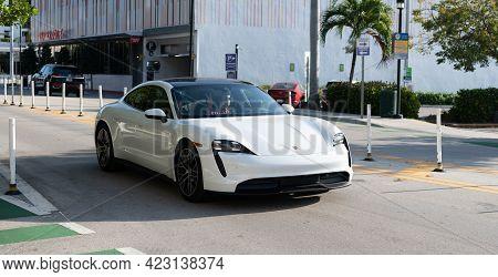 Miami Beach, Florida Usa - April 15, 2021: Porsche Taycan Turbo S Luxury Sport Car. Corner View.