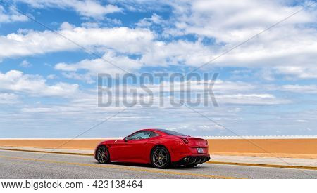 Palm Beach, Florida Usa - March 21, 2021: Red Ferrari California Luxury Car Moving On Road