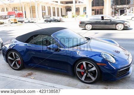 Long Beach, California Usa - April 11, 2021: Blue Porsche 911 Carrera. Side View.