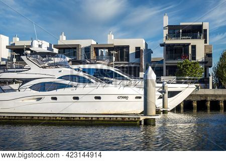 Melbourne, Australia - May 17, 2019: Luxury Waterfront Apartments And Boats Viewed From The Yarra Ri