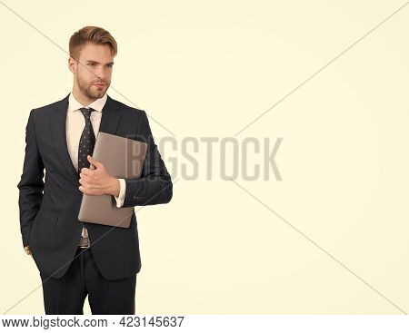 Electronic Commerce. Salesman Hold Laptop. E-commerce Business. E-shop. E-business. Internet Marketi
