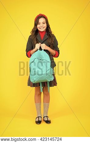 Schooling In Style. Happy Child Hold School Backpack Yellow Background. Book Bag Of Knowledge. Septe