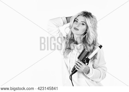 Hairstyle And Hairdressing. Girl Curling Long Hair With Curler. Girl Care About Her Hairstyle. Woman