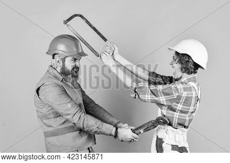 Builder Fighting. Real Estate Deal. Couple Of Architect Wear Hardhat. New House Construction Concept