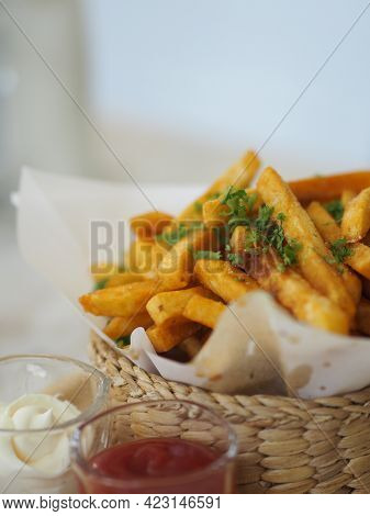 French Fries, Potato Chips Yellow Crispy Fries In Wooden Basket With Tomato Sauce And Mayonnaise In