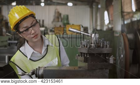 Asian Professional Mechanical Engineer Or Operation Woman Wearing Uniform Goggles Safety Working On